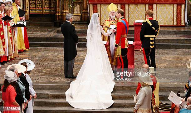 Prince William exchanges rings with his bride Catherine Middleton now to be known as Catherine Duchess of Cambridge in front of the Archbishop of...