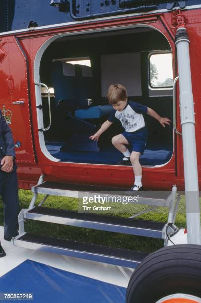 Prince William exits a helicopter of the Royal Flight after a brief flight over Highgrove House in Doughton Gloucestershire 18th July 1986