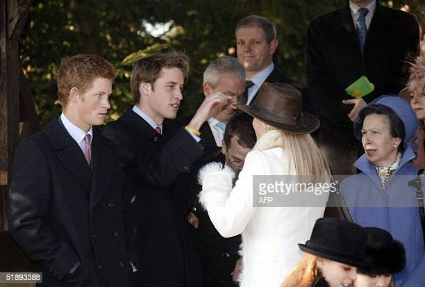 Prince William, flanked by his brother Harry ,shows interest in Zara Phillips bush hat as they arrive for Christmas Day service at Sandringham 25...