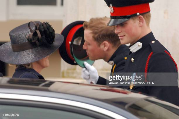 Prince William gives Camilla, Duchess of Cornwall a kiss as Prince Harry looks on at the passing-out Sovereign's Parade at Sandhurst Military Academy...