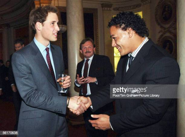 Prince William greets Chris Masoe of the All Blacks New Zealand rugby team during a special reception at Buckingham Palace in London, November 14,...