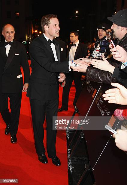 Prince William greets fans as he attends the Orange British Academy Film Awards 2010 at the Royal Opera House on February 21 2010 in London England