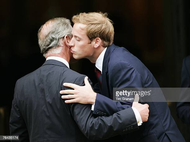 Prince William greets his father Prince Charles, Prince of Wales at the 10th Anniversary Memorial Service For Diana, Princess of Wales at Guards...