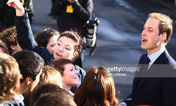 Prince William greets onlookers as he visits the University of St Andrews with Kate Middleton on February 25 2011 in St Andrews Scotland The couple...