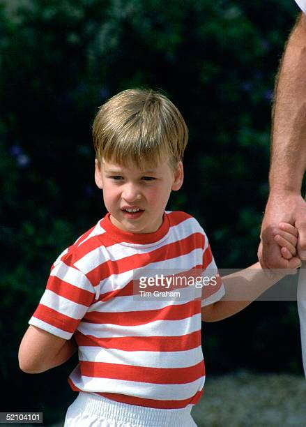 Prince William Holding His Father's Hand During A Photocall At The Marivent Palace Whilst On Holiday With The Spanish Royal Family.