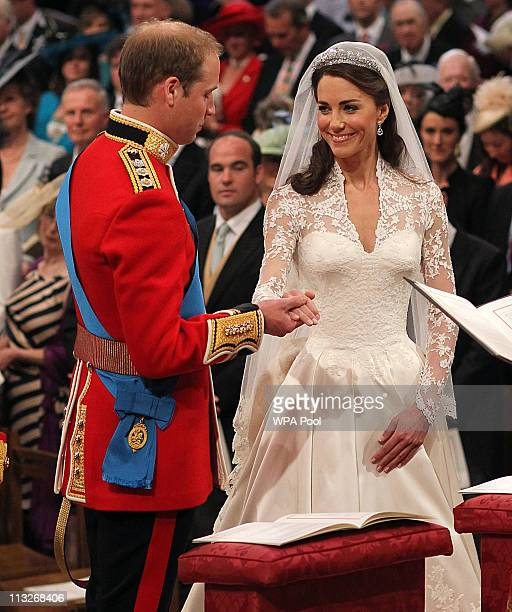 Prince William holds the hand of his bride Catherine Middleton inside Westminster Abbey on April 29, 2011 in London, England. The marriage of Prince...