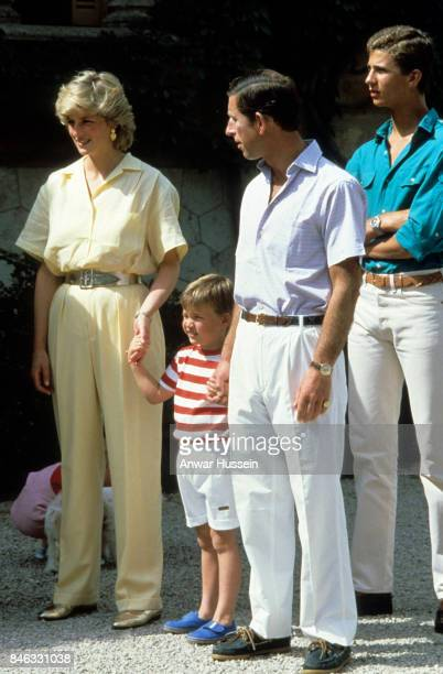 Prince William holds the hands of his parents Prince Charles Prince of Wales and Princess Diana Princess of Wales during a holiday in Majorca on...
