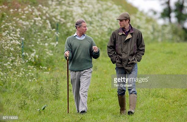 Prince William In Countryman Outfit Of Tweed Cap And Waxed Jacket And With His Hands In His Pockets Visits Duchy Home Farm With Prince Charles Who Is...