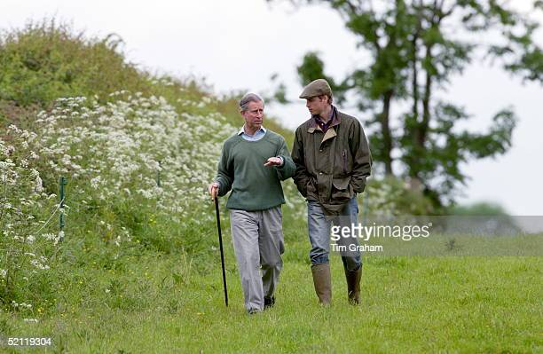 Prince William, In Countryman Outfit Of Tweed Cap And Waxed Jacket And With His Hands In His Pockets, Visits Duchy Home Farm With Prince Charles Who...
