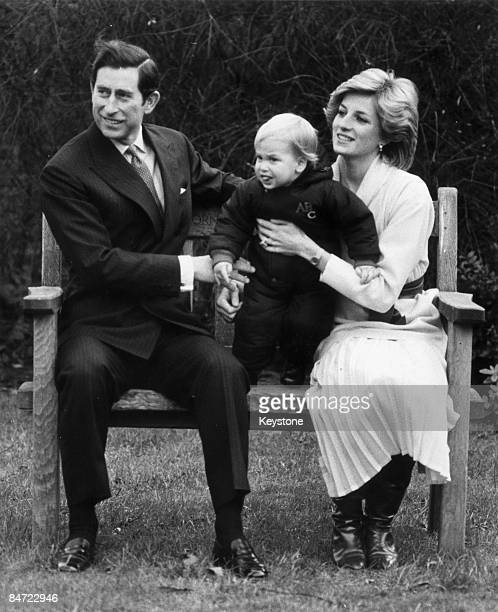 Prince William in the garden of Kensington Palace with his parents the Prince and Princess of Wales 14th December 1983