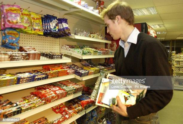 Prince William in the Good News newsagents in St Andrews showing that even Britain's most famous undergraduate resorts to a staple student diet of...