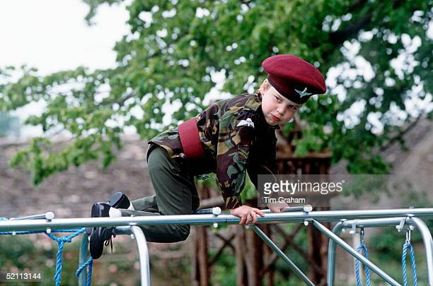 Prince William In The Uniform Of The Parachute Regiment Playing On A Climbing Frame At His Home Highgrove In Gloucestershire
