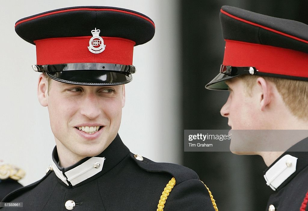 Prince William in uniform as an officer cadet, chats with his brother Prince Harry at the Sovereign's Parade at Sandhurst Military Academy on April 12, 2006 in Surrey, England.