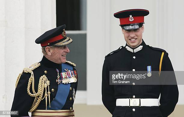 Prince William in uniform as an officer cadet , chats with his grandfather Prince Philip, Duke of Edinburgh on the steps of the Old College after the...