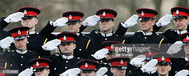Prince William , in uniform as an officer cadet, salutes with fellow soldiers at Sovereign's Parade at Sandhurst Military Academy on April 12, 2006...