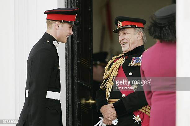 Prince William in uniform as an officer cadet, talks to General Sir Michael Jackson on the step of the Old College after the Sovereign's Parade at...