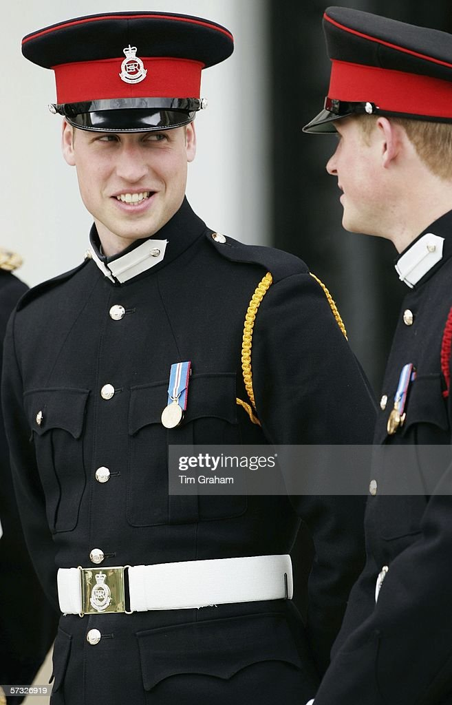 Prince William in uniform as an officer cadet, talks with his brother at the Sovereign's Parade at Sandhurst Military Academy where Prince Harry passed-out as commissioned officer Second Lieutenant Harry Wales of the Blues and Royals on April 12, 2006 in Surrey, England.