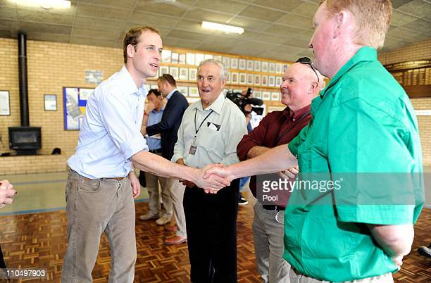 Prince William is greeted by locals at the Murrabit Recreational Centre on March 21 2011 in Murrabit Australia Prince William is on a tour of natural...