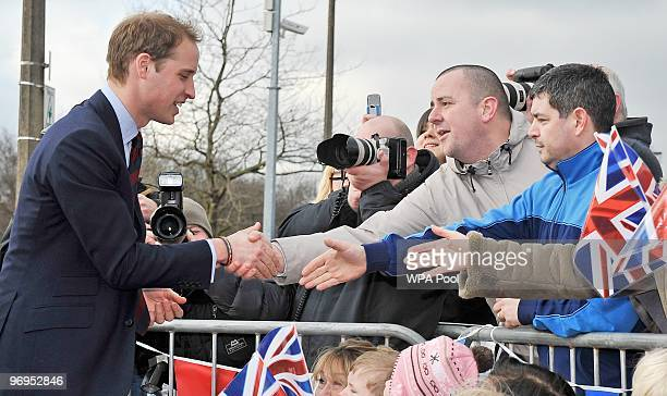Prince William is greeted by well wishers as he departs after a visit to Alder Hey Children's Hospital where he officially launched their new...