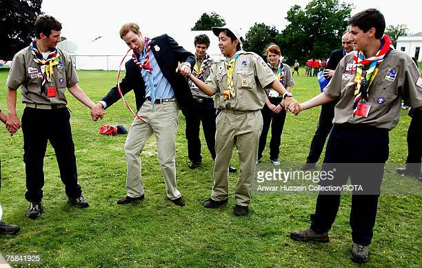 Prince William joins in traditional scout games as he attends the opening of the 21st World Scout Jamboree at Hylands Park on July 28 2007 in...