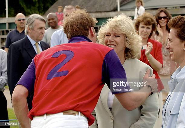 Prince William kisses The Duchess of Cornwall during the Burberry Cup at Cirencester Park Polo Club on June 17 2005 in Gloucestershire England
