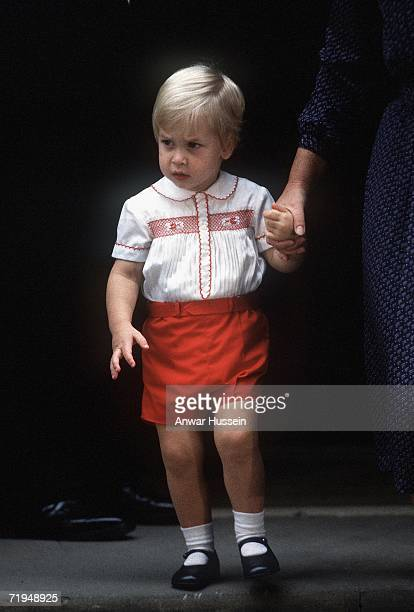 Prince William leaves St Mary's Hospital after visiting his newborn brother, Prince Harry, on September 16, 1984 in London, England.