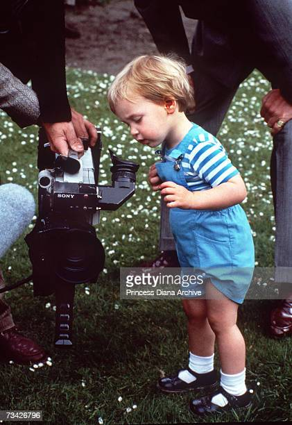Prince William looking at a TV camera during a photocall with his parents in the gardens of Kensington Palace London May 1984