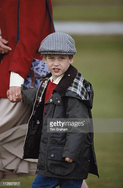 Prince William looking every inch the country gentleman in his waxed jacket and tweed cap at Cirencester Park Polo Club in Cirencester Glocestershire...
