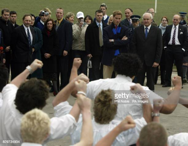 Prince William looks on as pupils from Christchurch High School for boys perform the school Maori haka at the end of his visit