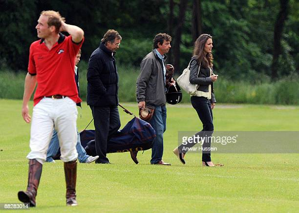 Prince William looks puzzled as Kate Middleton walks past during a charity polo match at Cirencester Park Polo Club on June 7 2009 in Cirencester...