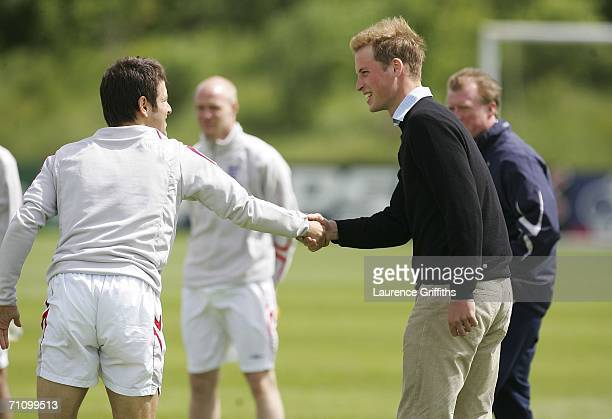 Prince William meets Joe Cole of England during training ahead of the International Friendly against Jamaica on June 1 2006 in Manchester England