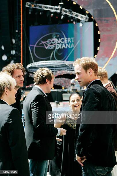 Prince William meets members of the band Duran Duran Simon Le Bon Nick Rhodes and John Taylor before the 'Concert for Diana' at Wembley Stadium which...