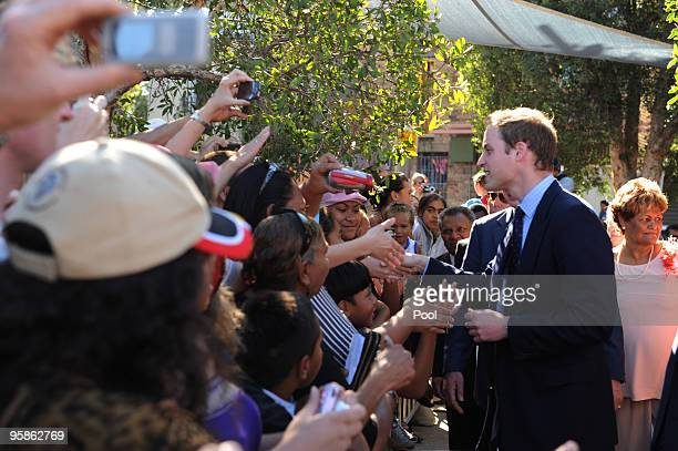 Prince William meets with members of the local Redfern aboriginal community during a visit to the Redfern Community Centre on on January 19 2010 in...