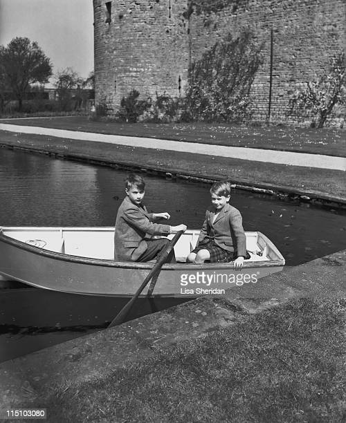 Prince William of Gloucester with his brother Prince Richard of Gloucester pictured in a rowing boat at their home at Barnwell Manor,...