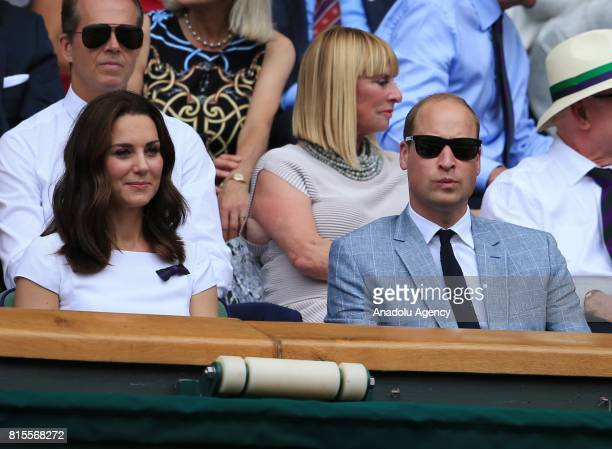 Prince William of Great Britain and his wife Katherine watch Roger Federer of Switzerland in action against Marin Cilic of Croatia from the royal box...