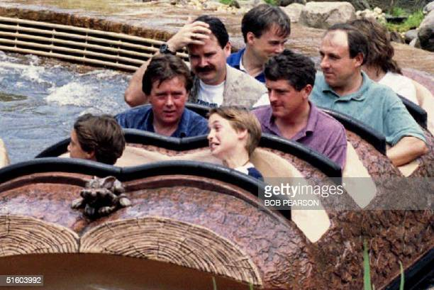 Prince William of Wales grimaces after he and friends of the royal family finished their ride 26 August 1993 on Splash Mountain at Disney World's...