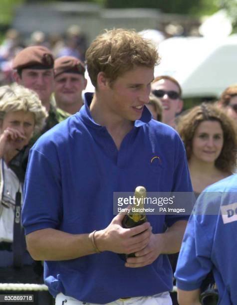 Prince William on the Jockeys team with his bottle of Champagne after the Jockeys v Eventers Charity polo match at Tidworth Polo Club Wiltshire