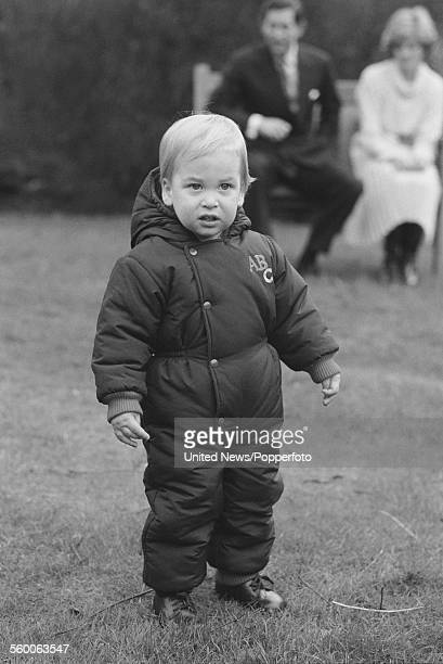 Prince William pictured with his parents Prince Charles and Diana Princess of Wales sitting behind attends his first press photo call in the garden...