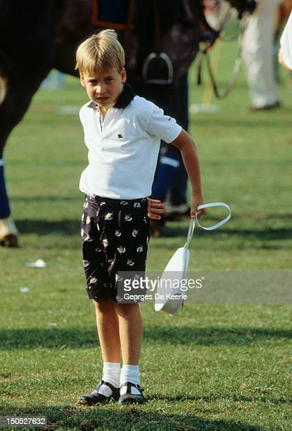 Prince William playing with Princess Diana's handbag at Cartier International Polo Day at Smiths Lawn Polo Club