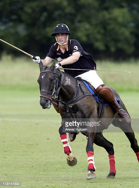Prince William plays polo at the Beaufort Polo Club on July 31 2002 in Beaufort England