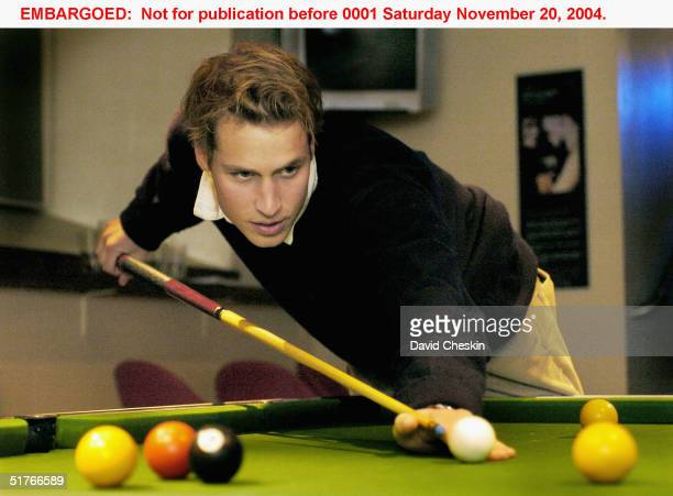 Prince William plays pool with friends at a pub on November 15 2004 in St Andrews Scotland The Prince is in the last year of his fouryear course at...