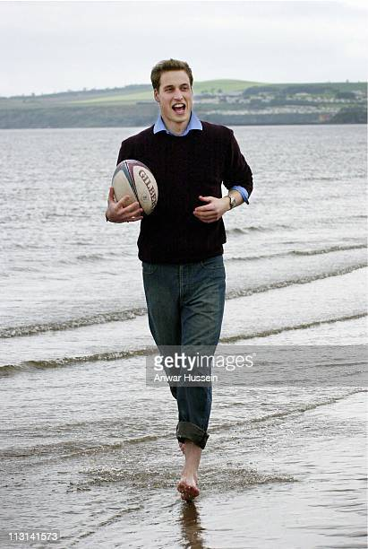 Prince William plays with a rugby ball on the beach while at university on May 28 2003 in St Andrews Scotland