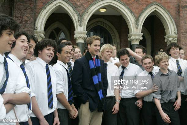 Prince William poses for photographs with pupils from Christchurch High School for boys who performed the school Maori haka at the end of his visit