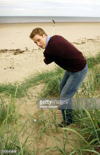 Prince William practises his golf on the beach while at university on May 28 2003 in St Andrews Scotland
