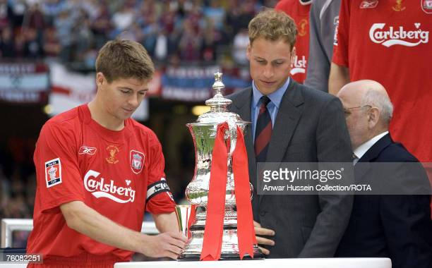Prince William presents the FA Cup to Liverpool Captain Steven Gerrard at the FA Cup final between Liverpool and West Ham United at the Millenium...