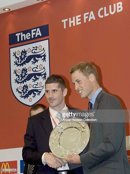 HRH Prince William presents the 'players of the rounds' awardsin the FA Club marquee before the FA Cup final between Liverpool and West Ham United at...
