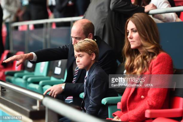 Prince William, President of the Football Association along with Catherine, Duchess of Cambridge with Prince George during the UEFA Euro 2020...