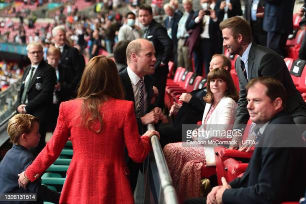 Prince William, President of the Football Association along with Catherine, Duchess of Cambridge and Prince George with David Beckham during the UEFA...