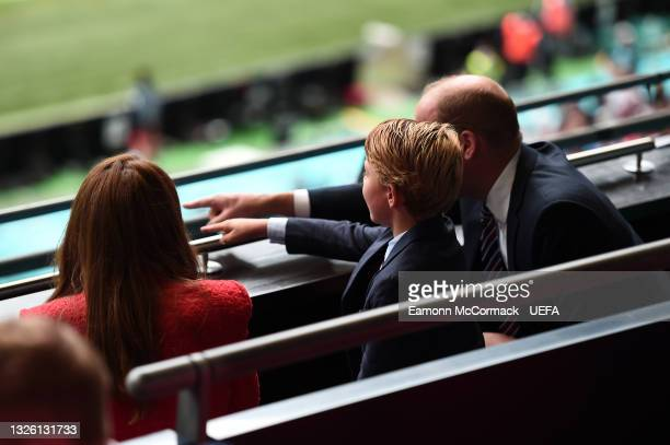 Prince William, President of the Football Association along with Catherine, Duchess of Cambridge and Prince George during the UEFA Euro 2020...