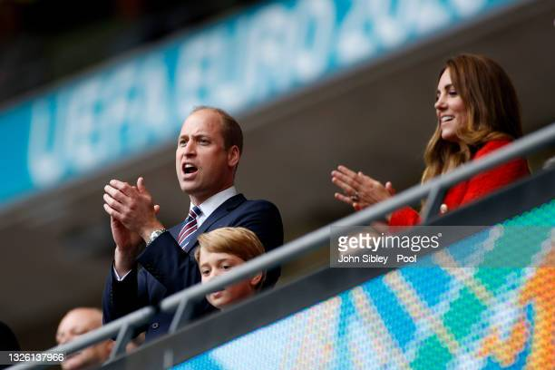 Prince William, President of the Football Association and his son Prince George along with Catherine, Duchess of Cambridge applaud after the UEFA...